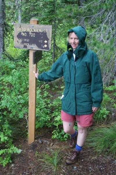 Tasha by the Shellrock Lake Trail sign