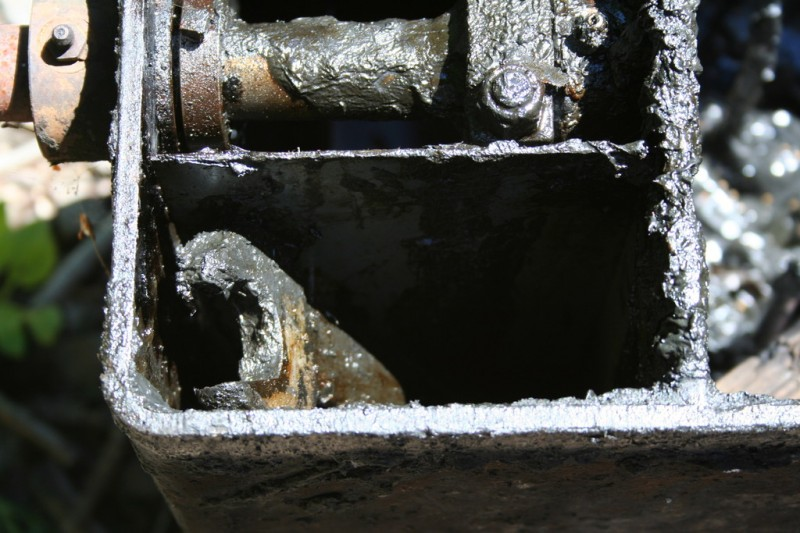 A greasy wrench inside the lubricator tank