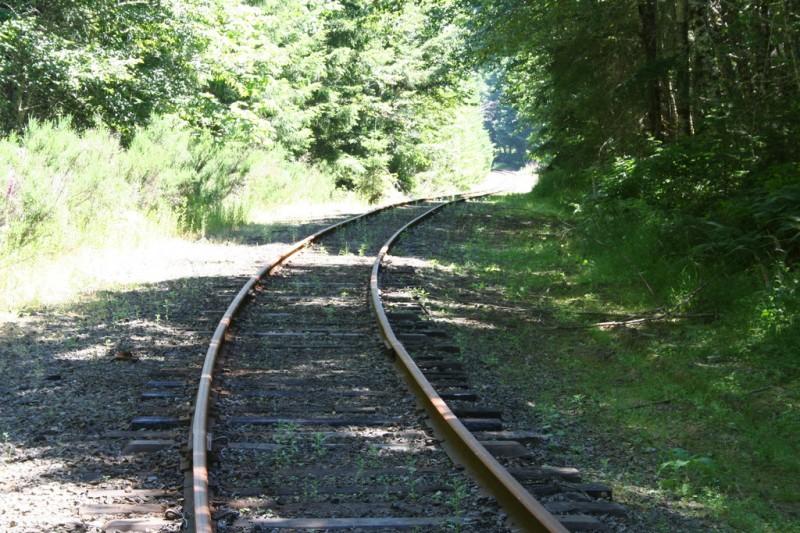 Railroad track curving around a corner