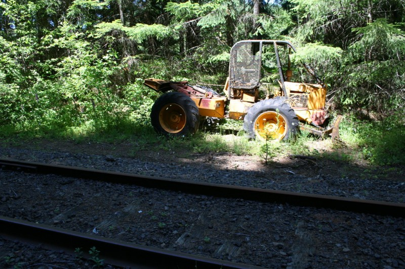 A small loader apparently abandoned near the tracks