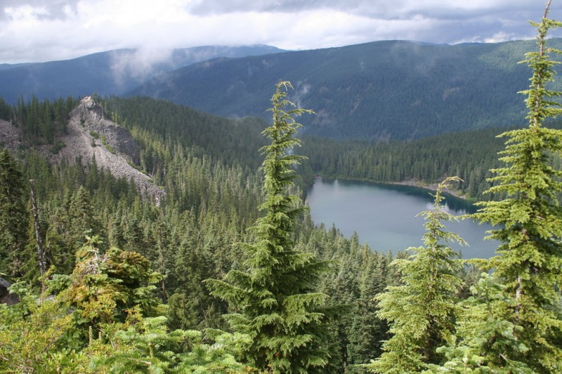 Serene Lake from the viewpoint with a rocky ridge above it and t