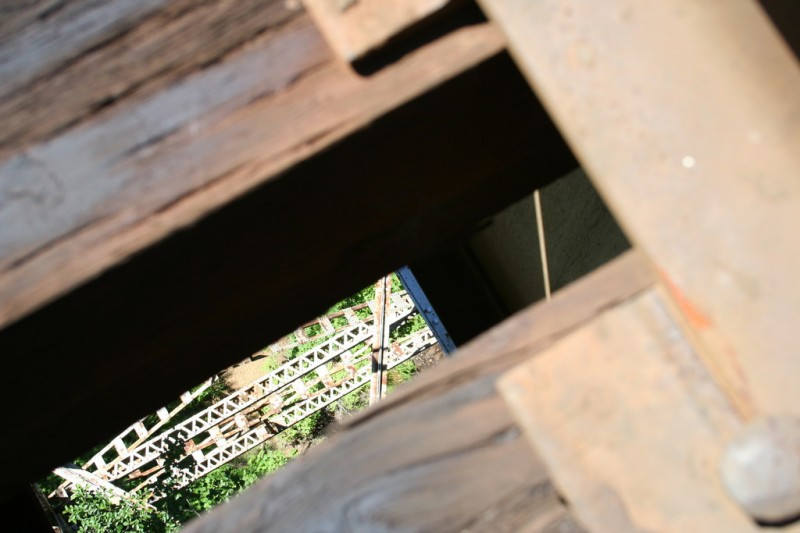 Looking down through the planks at a trestle support