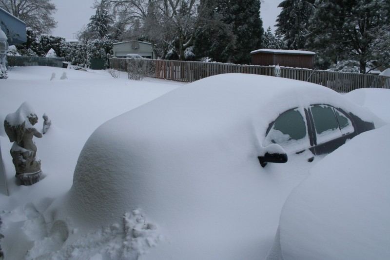 My Snow Covered Jetta in the Daylight with Tons More Snow
