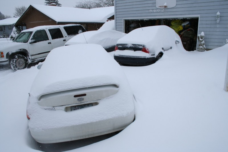 Snow-Covered Cars in the Driveway