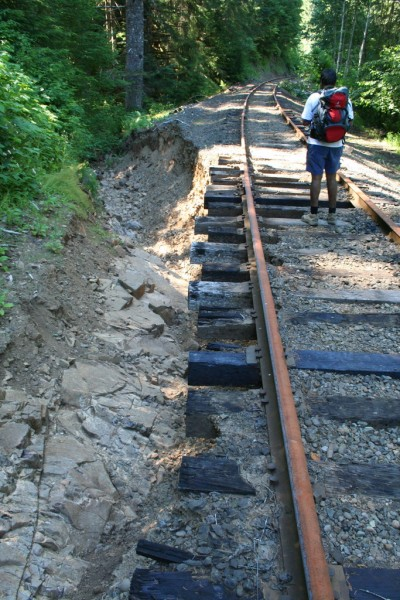Sam crossing a VERY washed out section of track