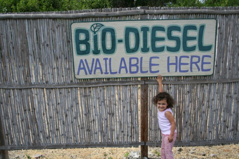 Allie and a Sign that Says Biodiesel Available Here