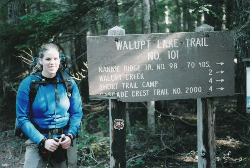 Alicia by the Trailhead Sign