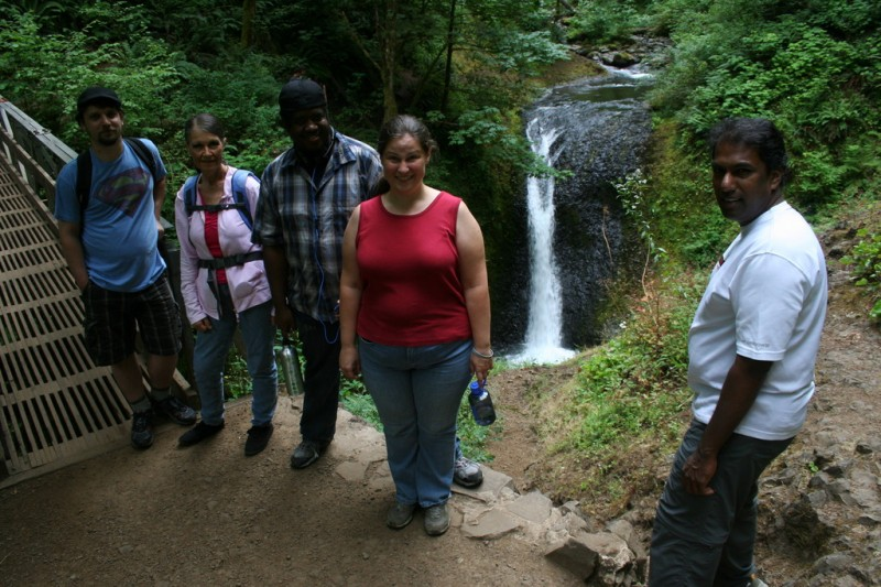 Phil, Mary Jo, Jelani, Holly and Sam in front of the waterfall by the bridge