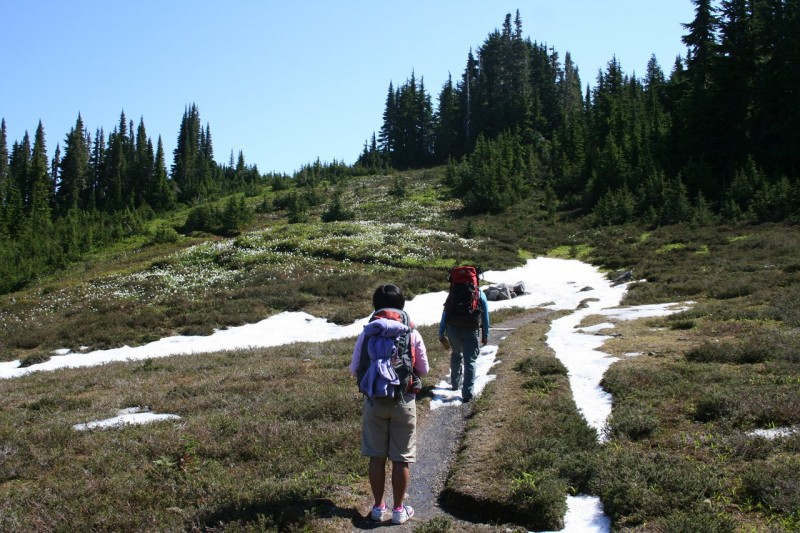 Chihiro and Kanako on a trail with snow on it