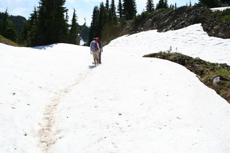 Kanako and Chihiro walking across a snowfield