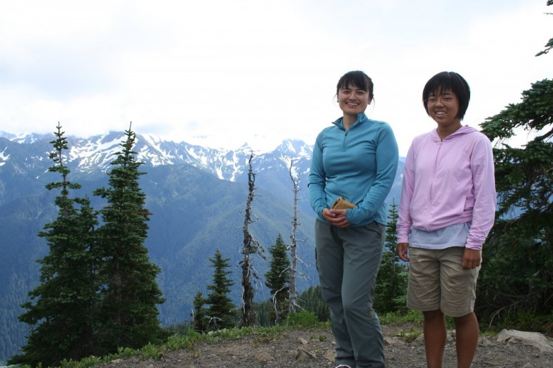 Kanako and Chihiro on Bogachiel Peak with the Bailey Range behind them