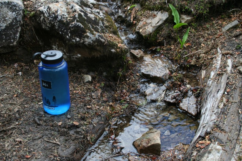 My nalgene bottle beside a small snowmelt stream
