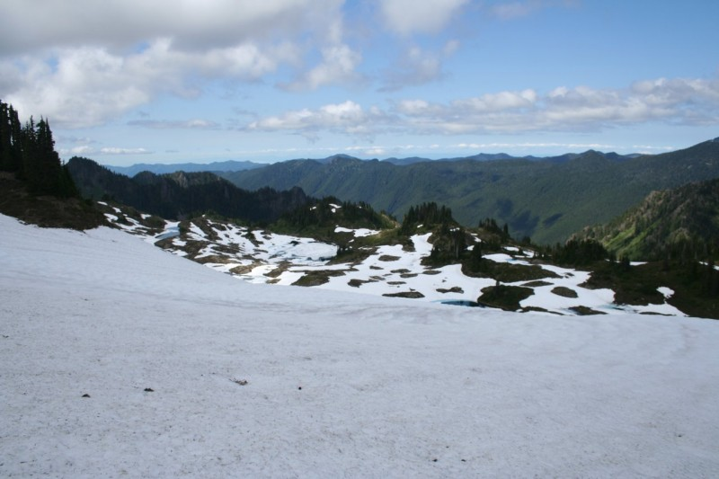 Snowfield on the High Divide Trail overlooking Seven Lakes Basin