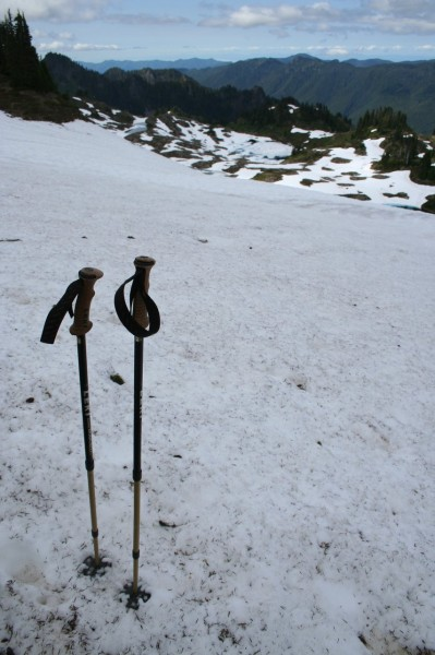 Trekking poles in the snow, Seven Lakes Basin in the background