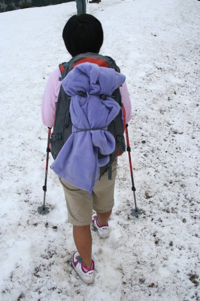 Chihiro hiking on the snow with trekking poles