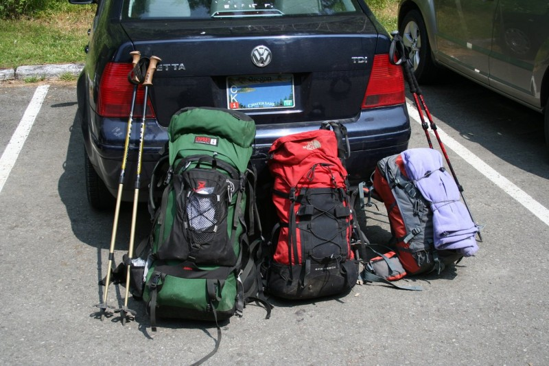 Our three backpacks and trekking poles leaning up against the back of my Jetta