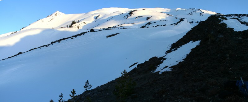 snow covered mt st helens from part way up with a rocky outcropping in the foreground