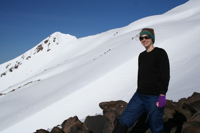 tasha with the snowy slope of mt st helens in the background