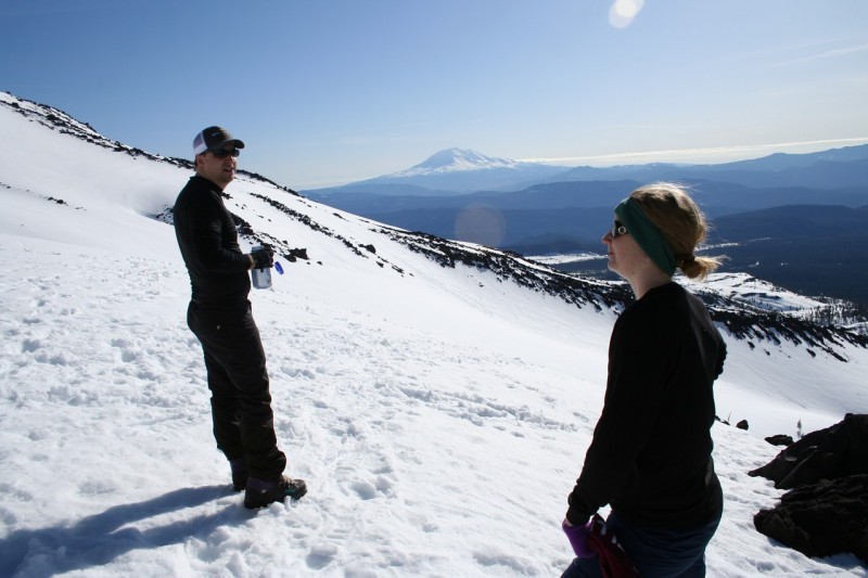 Troy and Tasha on either side of the photo with the slope of mt st helens and mt adams in the background