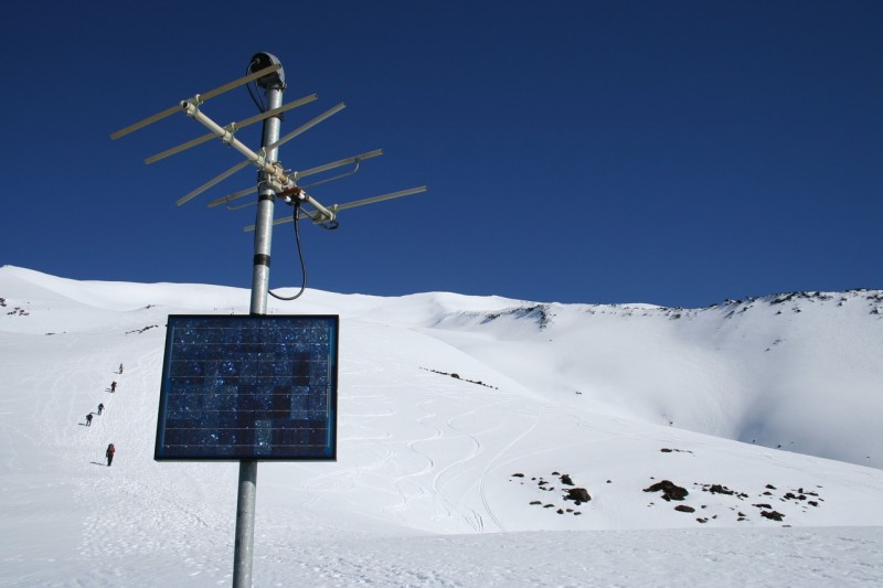 Close up of the solar panel and antenna in front of the view looking toward the top of mt st helens