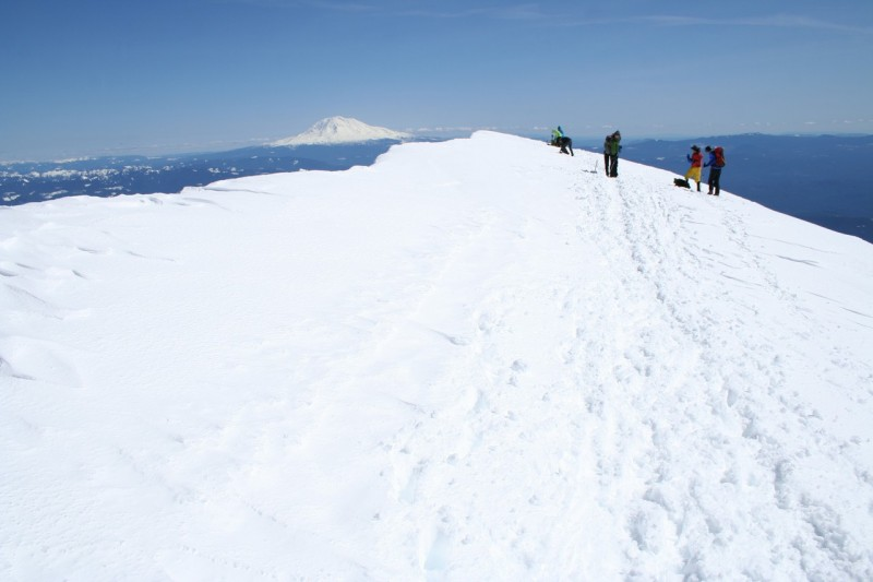 snowy sort of flat area at the rim of mt st helens looking sort of west with mt adams in the background