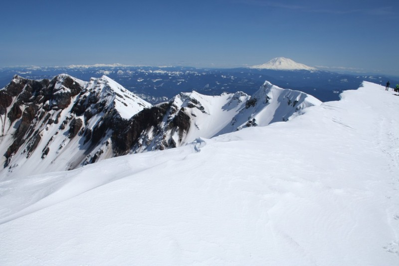 the snowy rim of mt st helens looking down into the crater and to the north