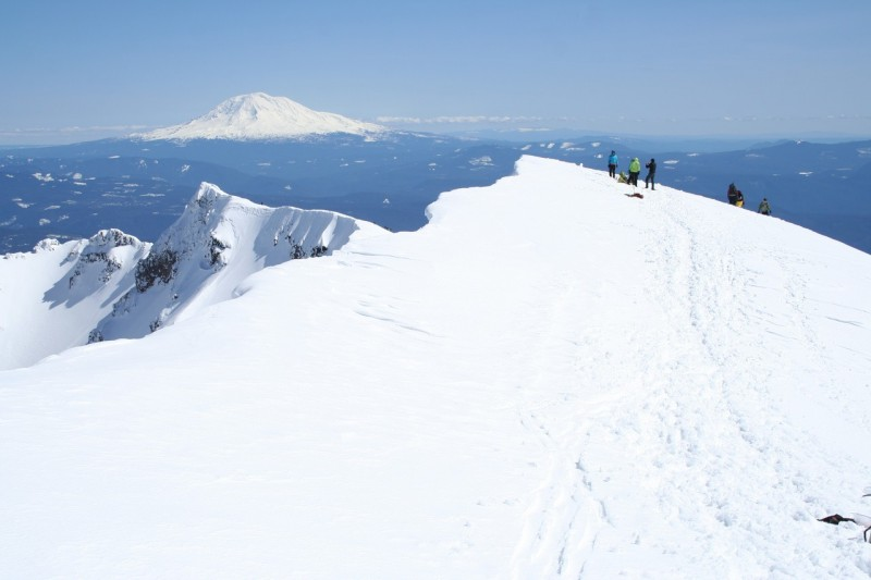 closer view of the southeastern side of the rim of mt st helens and mt adams in the background