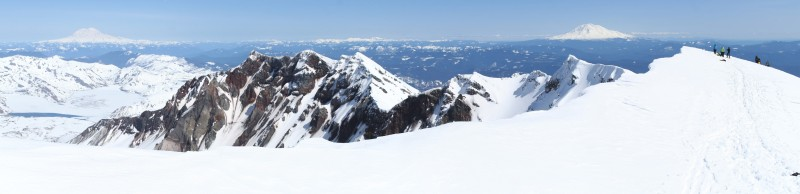 panoramic view of the eastern and southeastern sides of the rim of mt st helens with mt rainier and mt adams in the distance