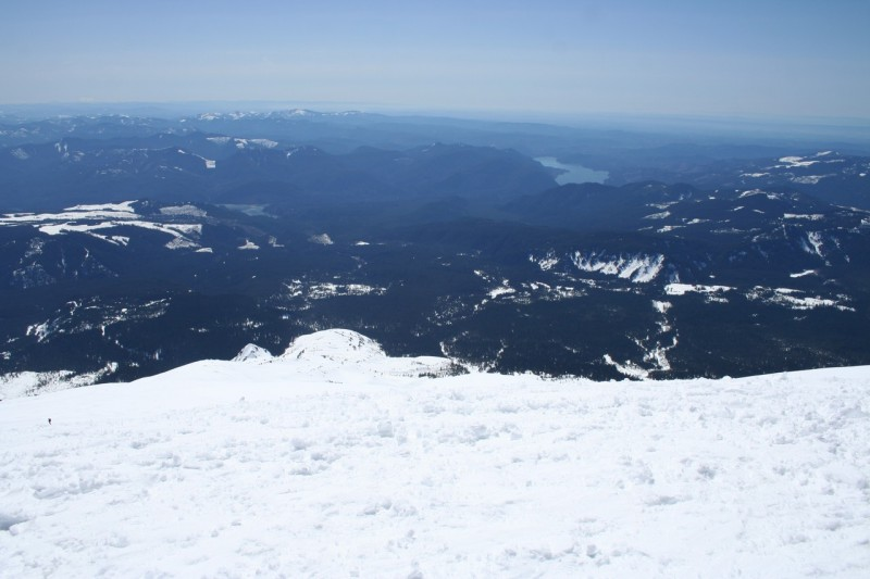 looking down the snowy slope of mt st helens from the top