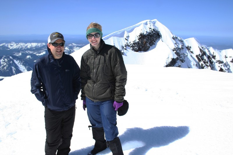 troy and tasha with the snowy western side of the rim of mt st helens in the background
